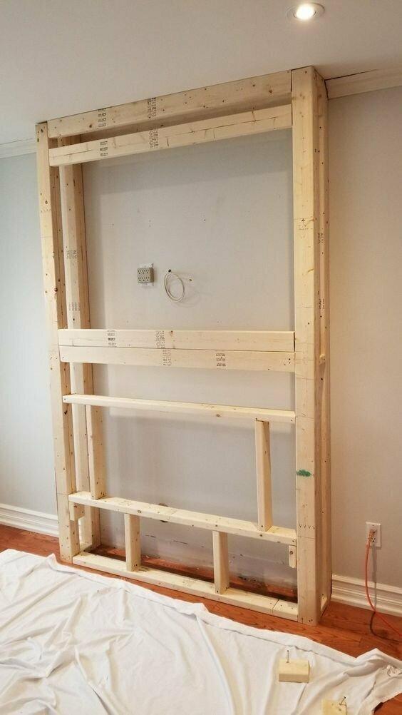 Проще всего сделать конструкцию из дерева и спрятать в нее все кабели