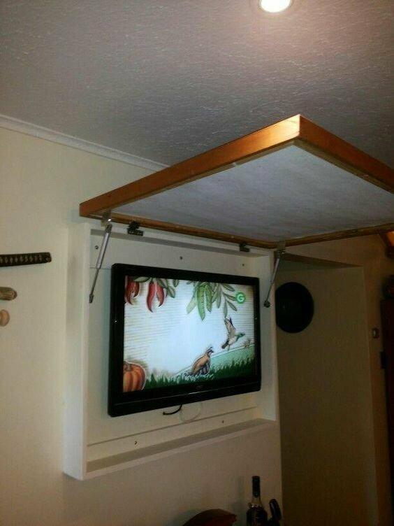 А это варианты, как можно спрятать телевизор в интерьере