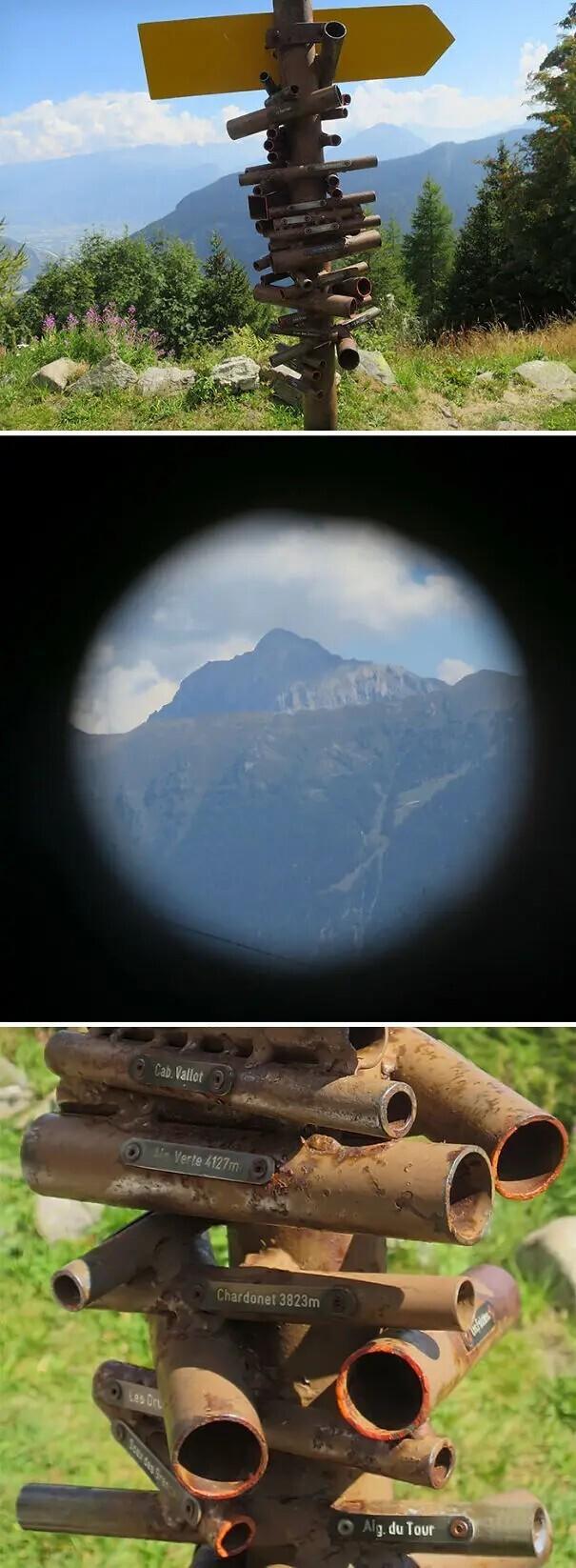 Столб с небольшими трубами, сквозь каждую из которых можно увидеть все пики Альпийских гор.