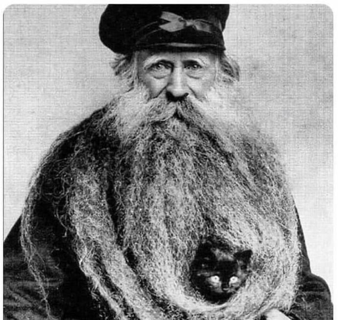 Луи Кулон - обладатель самой длинной 4-метровой бороды в мире, 1904г.